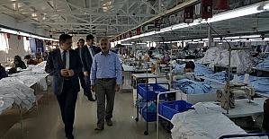 İlçe protokolü tekstilcilerle bir araya geldi