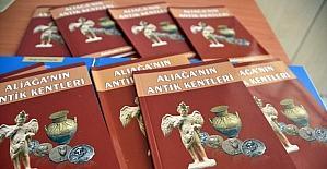 Aliağa'nın antik kentleri ve Güzelhisar kitaplarının dağıtımı başlandı