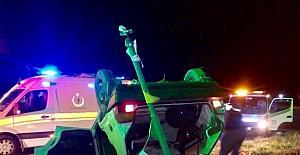 Takla atan araçtan hafif sıyrıklarla kurtuldu