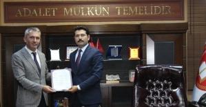 Ardahan Baro Başkanlığına Seçilen Osman Nuri Yıldız mazbatasını aldı
