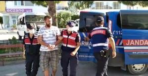 Jandarma 1 yıldır aranan zanlıyı çektiği fotoğraftan yakaladı