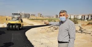 Osmangazi Mahallesinde yeni açılan yollar asfaltlanıyor