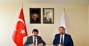 İKÇÜ ile Çiğli Belediyesi arasında işbirliği protokolü